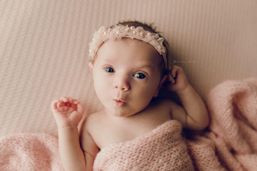 newborn baby girl pink eyes open